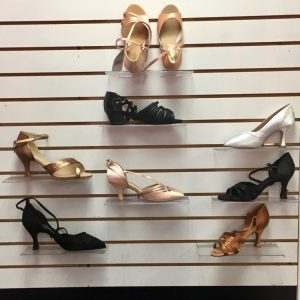 Black, tan, and white women's ballroom dance shoes