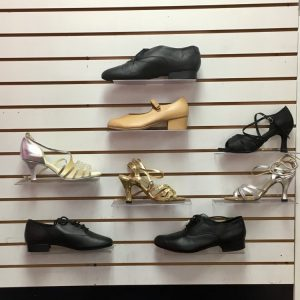 Black, tan, gold, and silver women and men's ballroom dance shoes