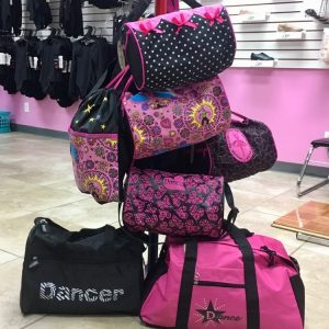 Black and pink small, medium, and large dance bags