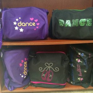 Small purple and black dance duffel bags