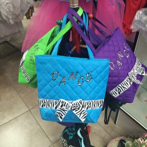 Green, blue, and purple dance tote bags