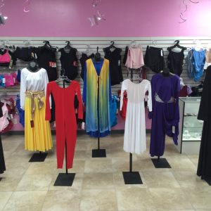 Seven different styles of praise dance dresses, leotards, robes, skirts, and pants