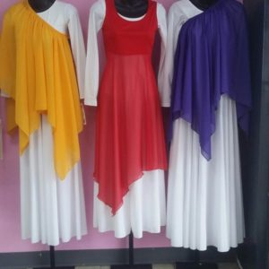 Yellow, red, and purple praise dance wear overlays on top of a white praise dance dress