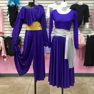 Metallic silver and gold sashes over purple praise dance uniforms