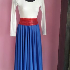 White long sleeve leotard with a blue skirt and red sash