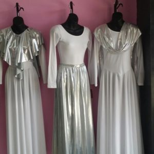 White leotard, praise skirt, and praise dress with metallic silver overlays and sash