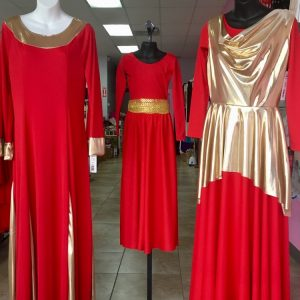 Three different red praise dresses with metallic gold trim, overlay and sash