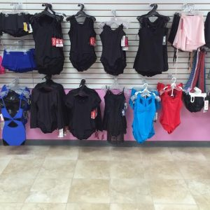 Black and colored adult leotards, dance shorts, and dance skirts