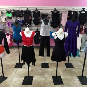 7 different uniforms of leotards, praise dance wear, ballroom garments, dance wear, and cheer gear
