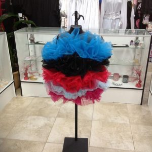Red, blue, black, and pink child and adult dance tutus